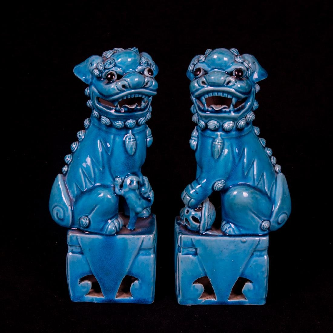 A Pair of Chinese Turquoise Glazed Porcelain Foo Dogs,