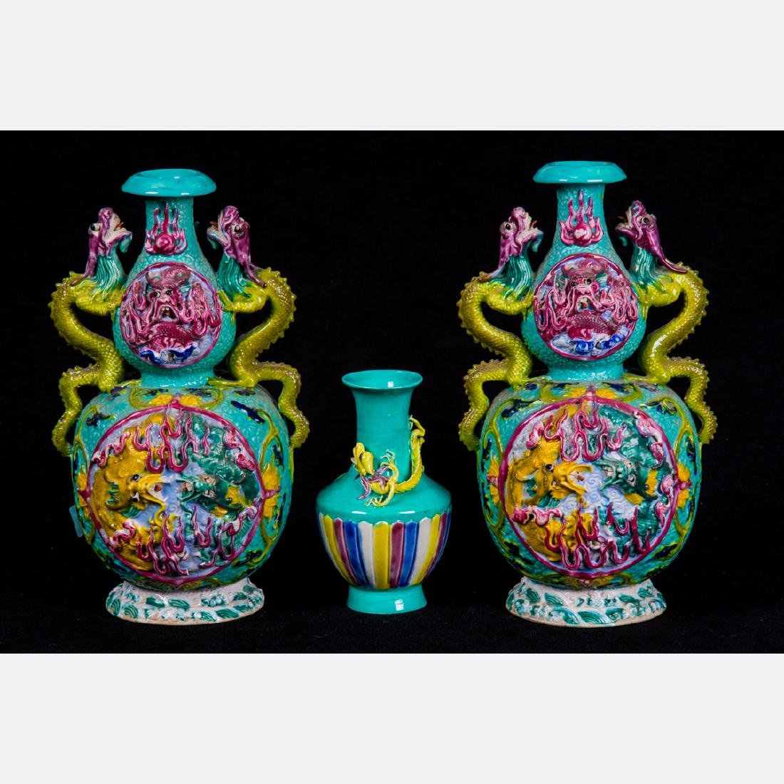 A Pair of Chinese Ceramic High Relief Vases Depicting a