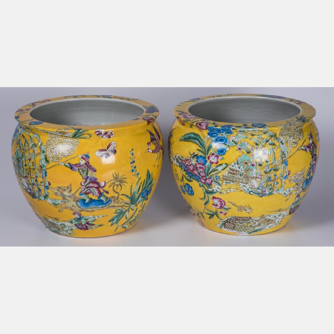 A Pair of Chinese Famille Jaune Porcelain Fish Bowls,