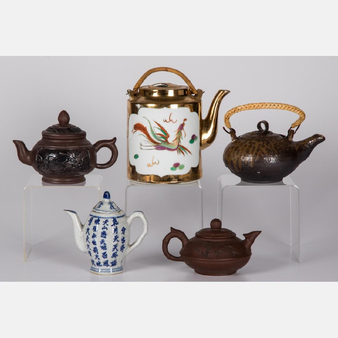 A Group of Five Asian Ceramic Teapots, 20th Century.