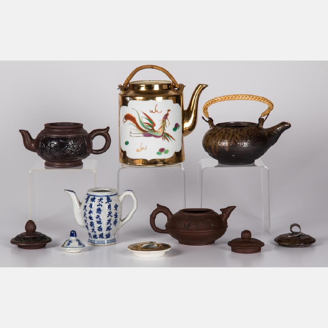 A Group of Five Asian Ceramic Teapots, 20th Century. - 2