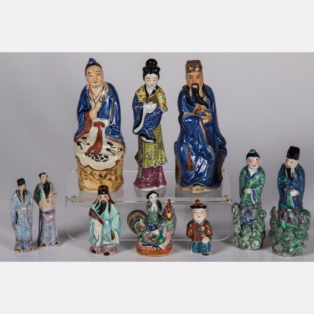 A Group of Ten Chinese Porcelain Figures of Men and