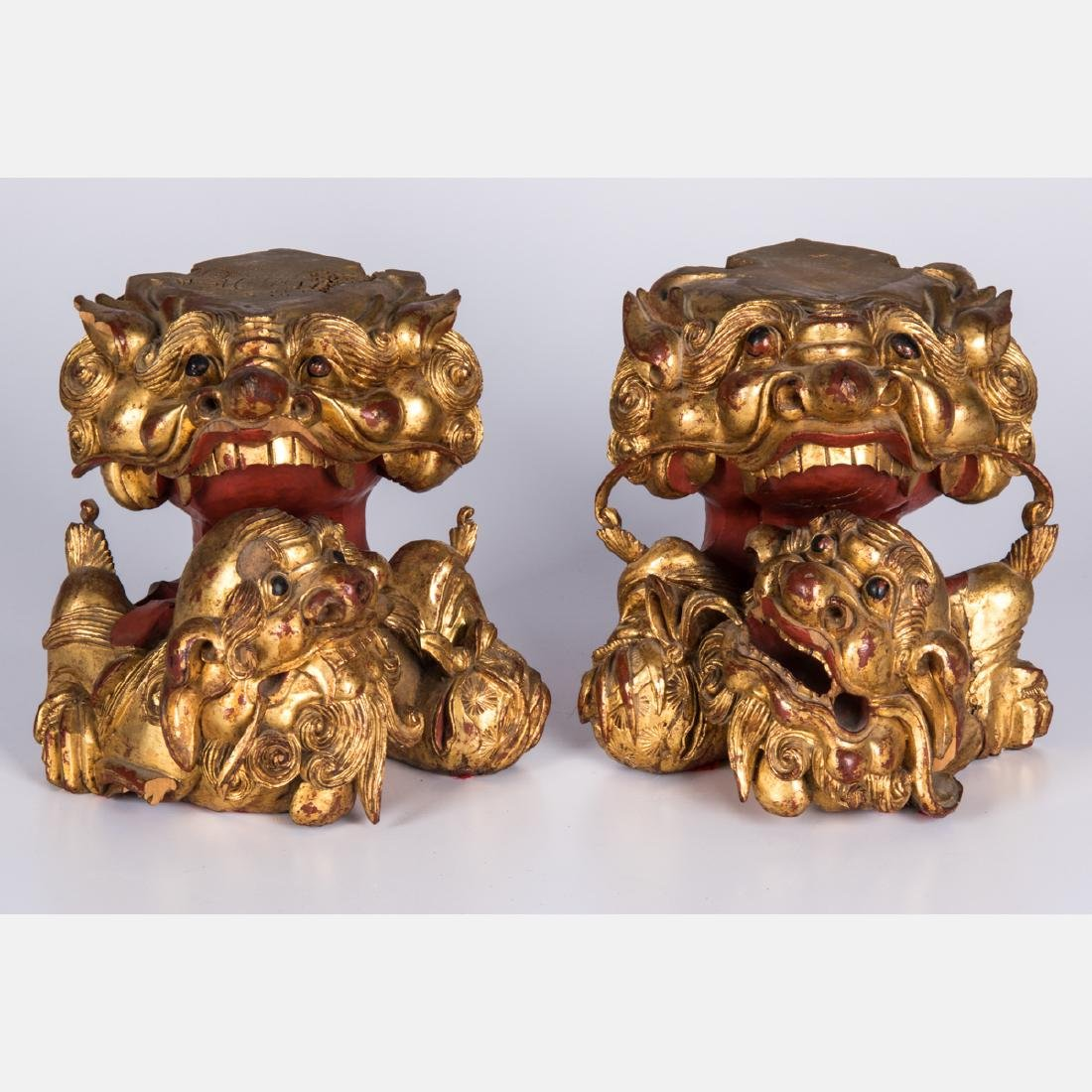 A Pair of Chinese Carved and Gilt Painted Wood Lion