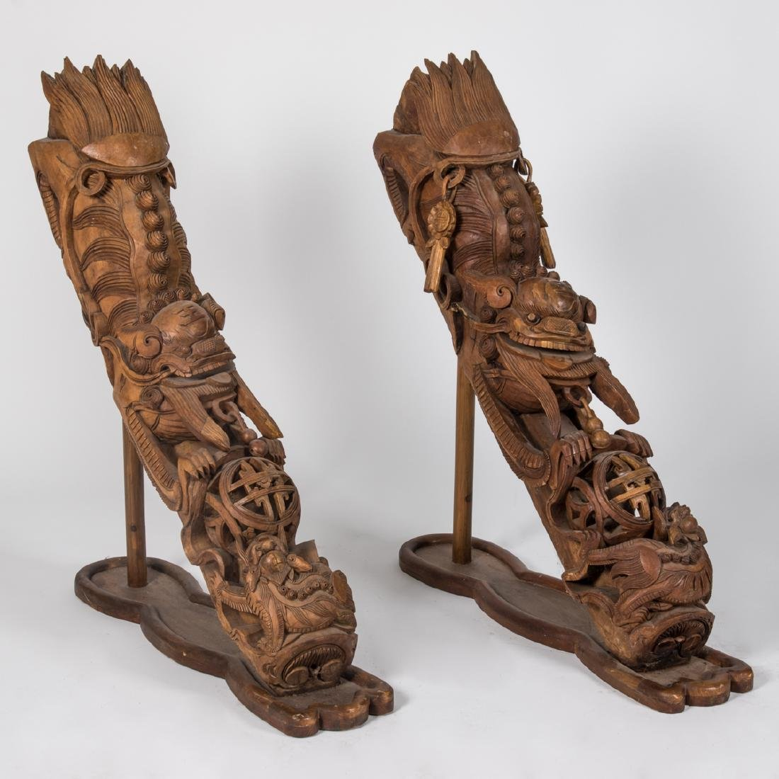 A Pair of Chinese Heavily Carved Elm Dragon Form