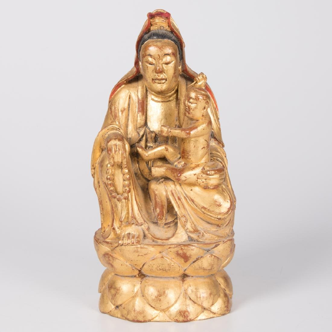 A Chinese Carved and Gilt Lacquered Wood Figure of