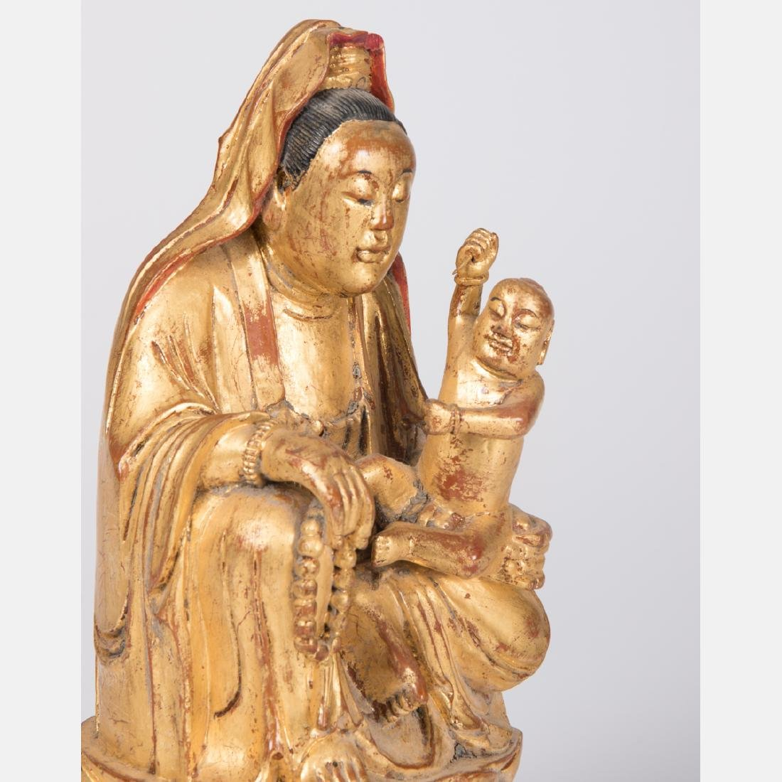 A Chinese Carved and Gilt Lacquered Wood Figure of - 3