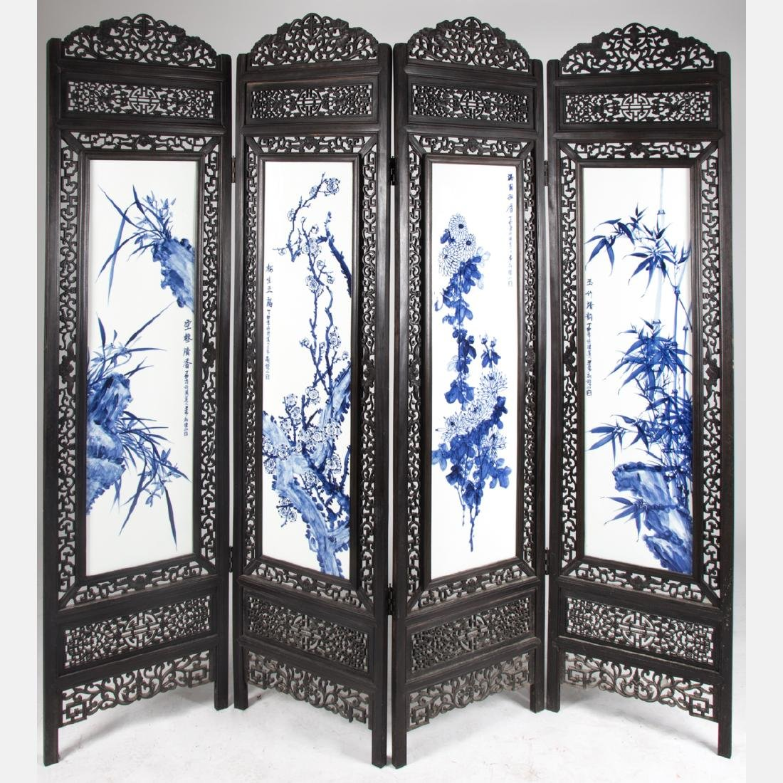 A Chinese Carved Hardwood, Blue and White Porcelain