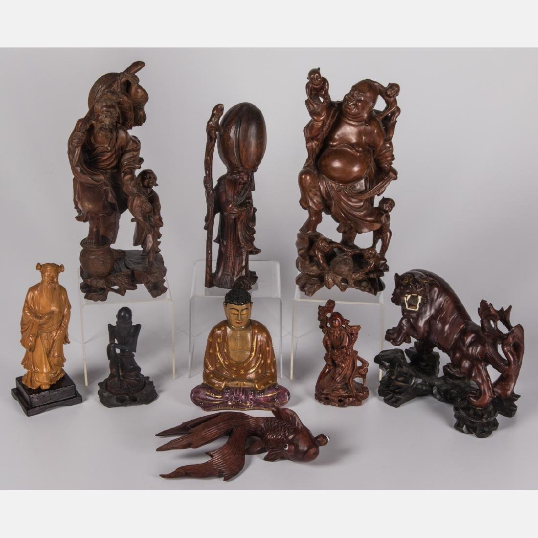A Group of Nine Chinese Carved Hardwood Figures,