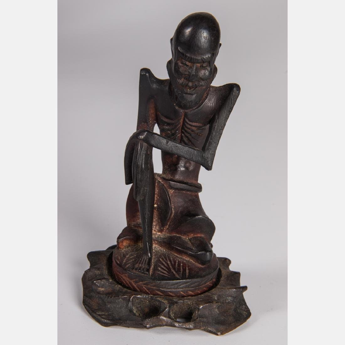 A Group of Nine Chinese Carved Hardwood Figures, - 9