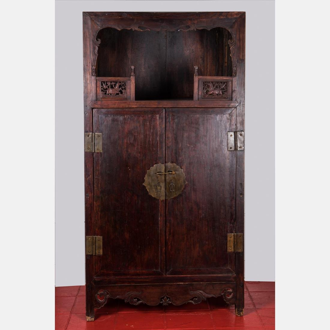 A Chinese Carved and Stained Elm Display Cabinet,