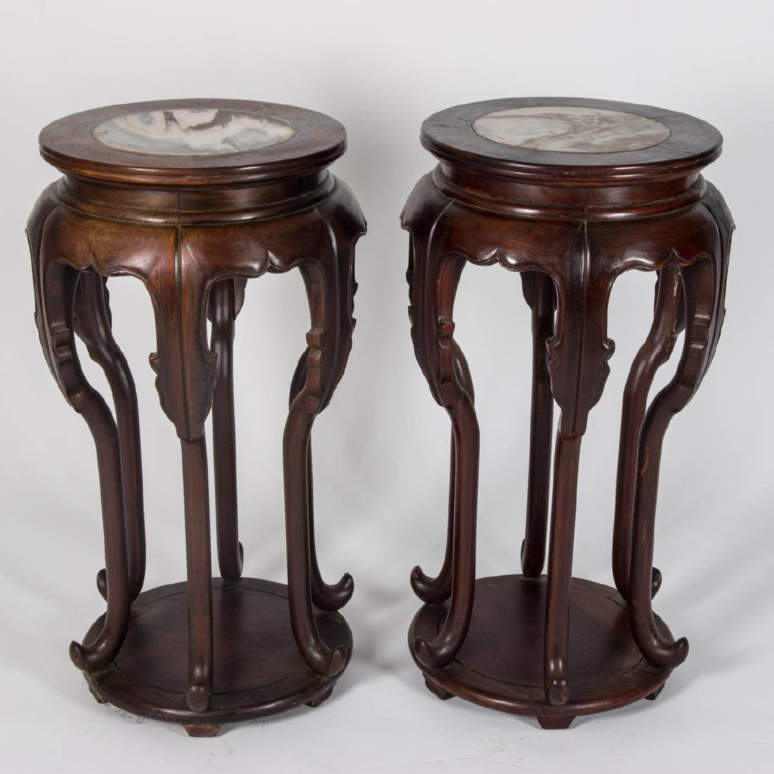 A Pair of Chinese Carved Rosewood Two Tier Pedestals,