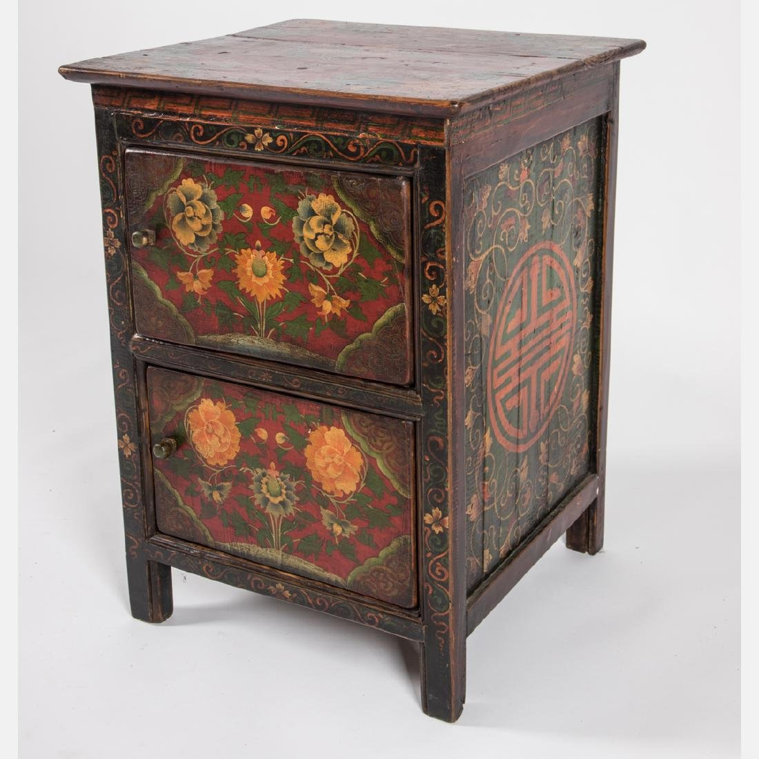 A Tibetan Painted Wood Two Drawer Side Table, 20th