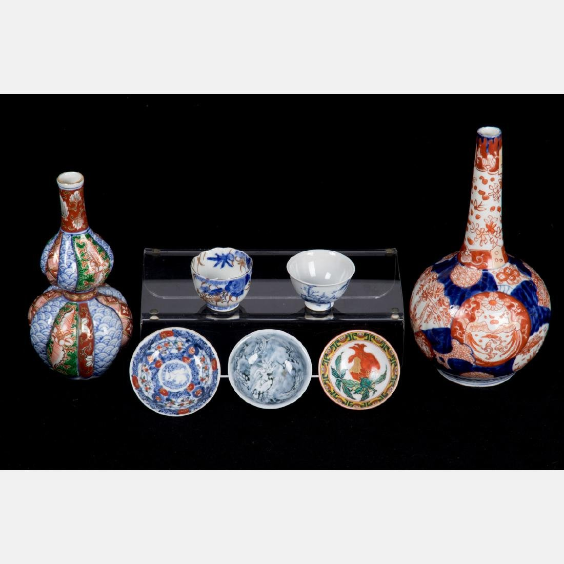 A Group of Seven Japanese Imari Porcelain Serving and