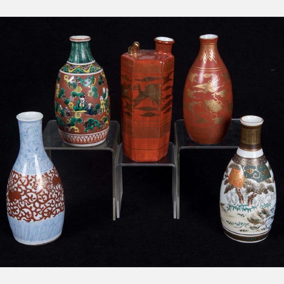 A Group of Five Japanese Porcelain Sake Bottles of
