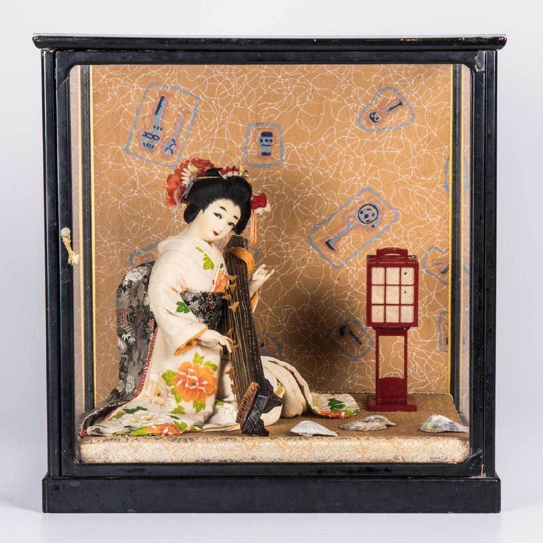 A Japanese Geisha Doll in a Shadow Box, 20th Century.