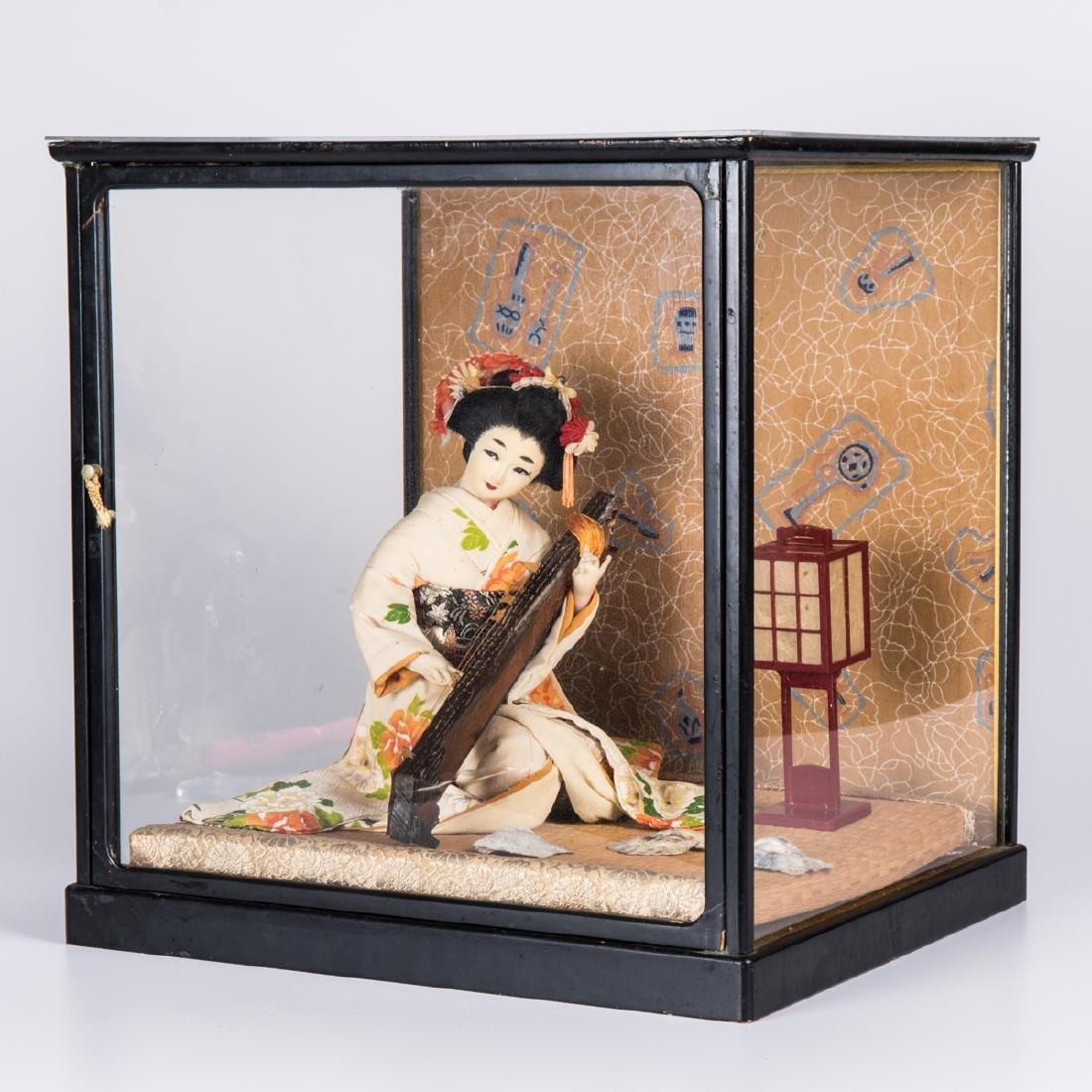 A Japanese Geisha Doll in a Shadow Box, 20th Century. - 2