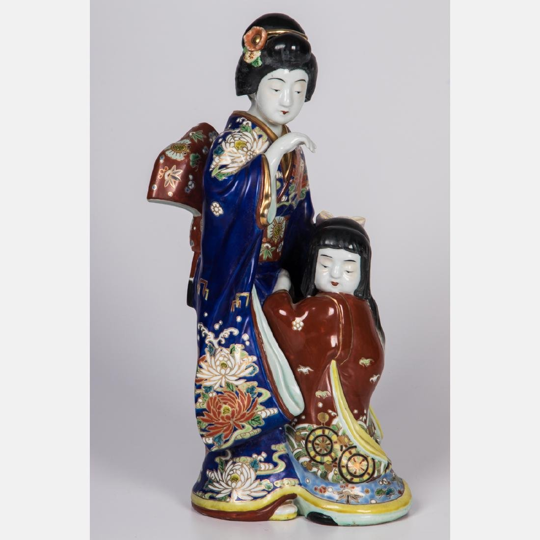 A Japanese Porcelain Figural Group, 20th Century.