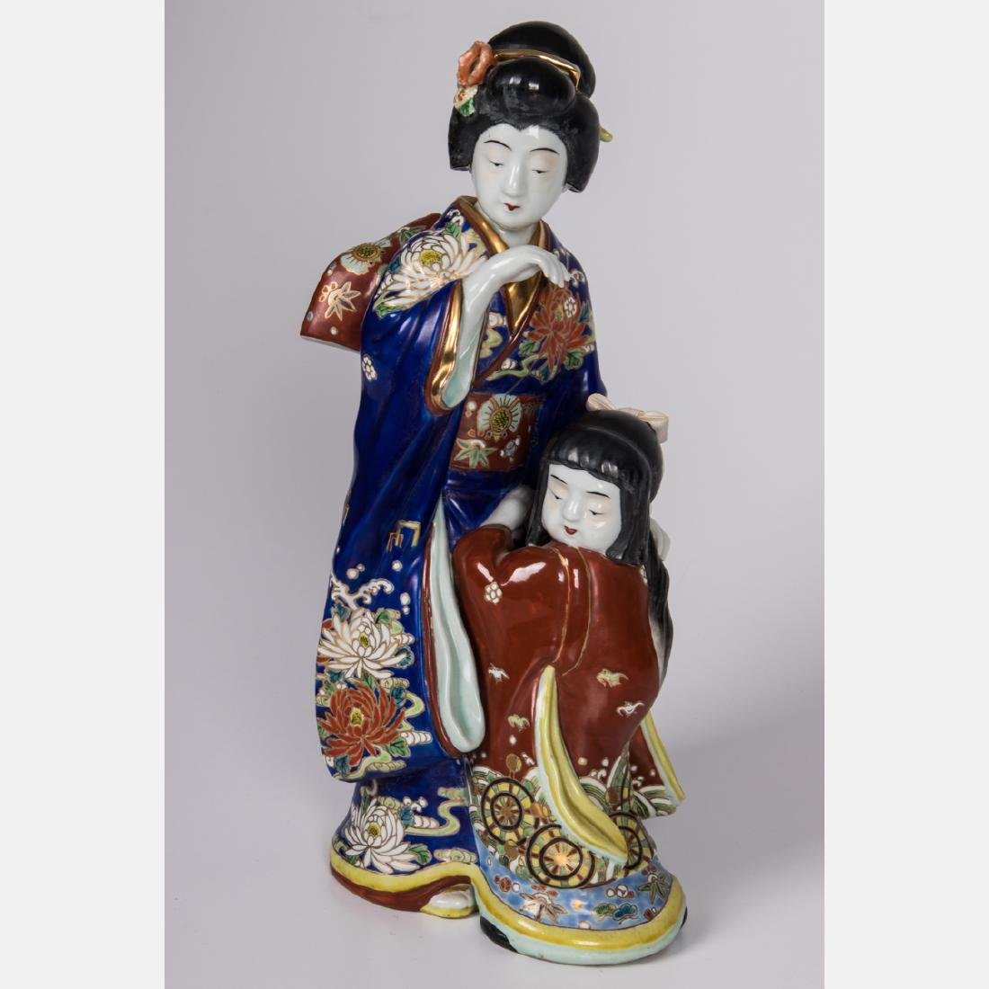A Japanese Porcelain Figural Group, 20th Century. - 2