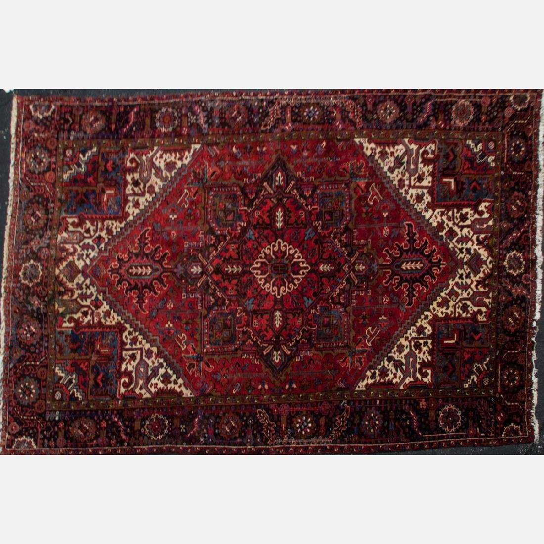 A Persian Wool Rug, 20th Century.