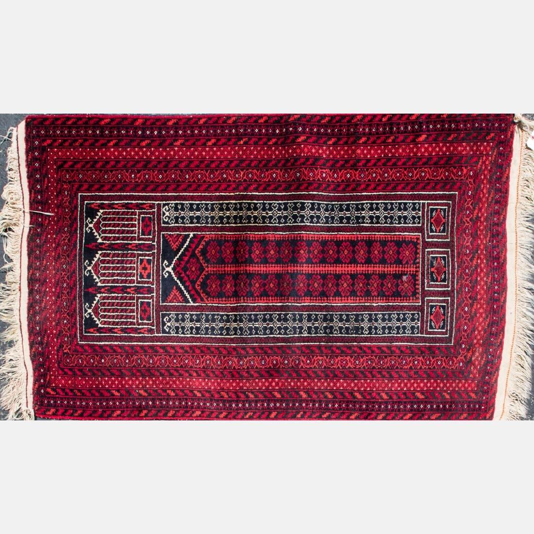 A Turkish Wool Rug, 20th Century.