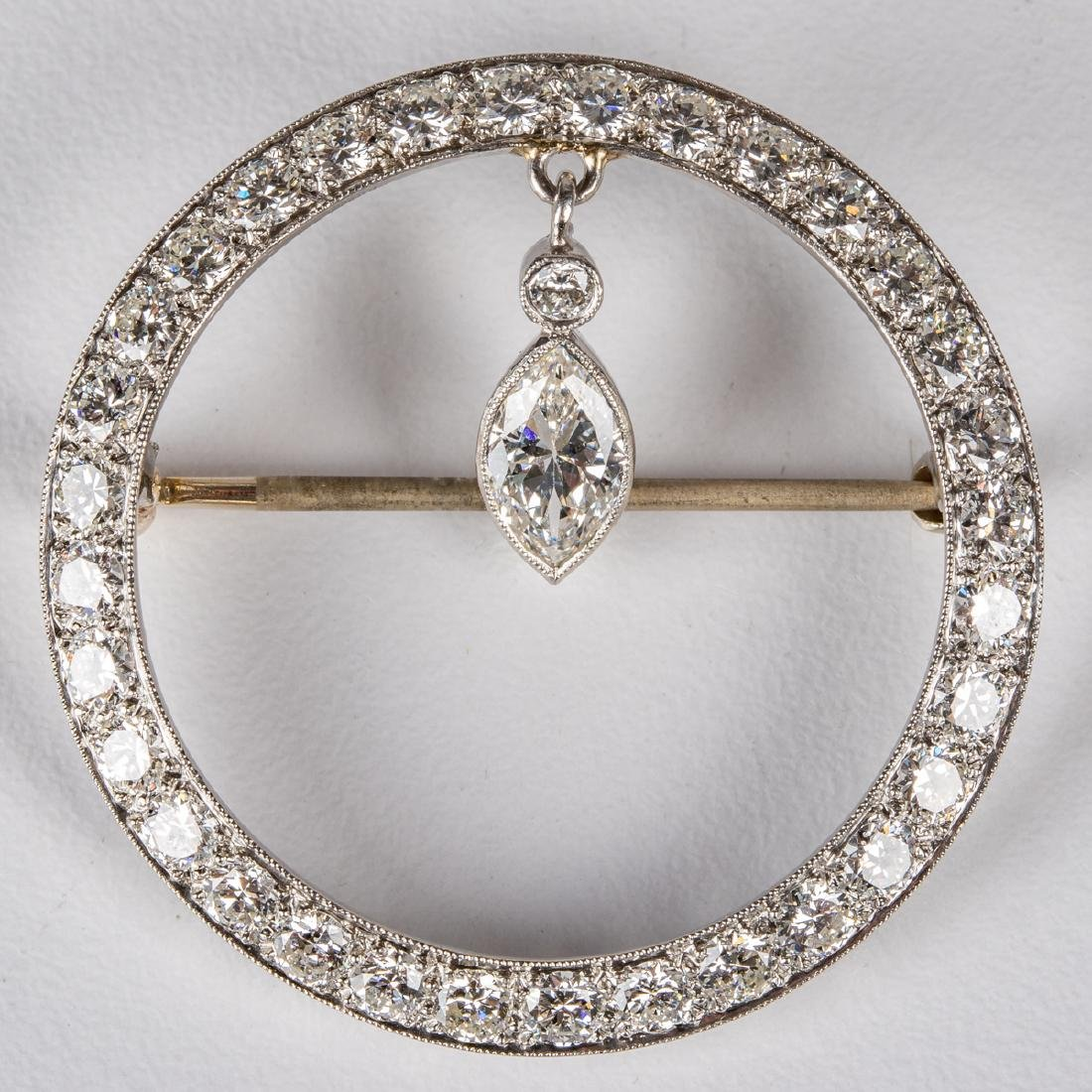 A 14kt. White Gold and Diamond Circular Brooch,