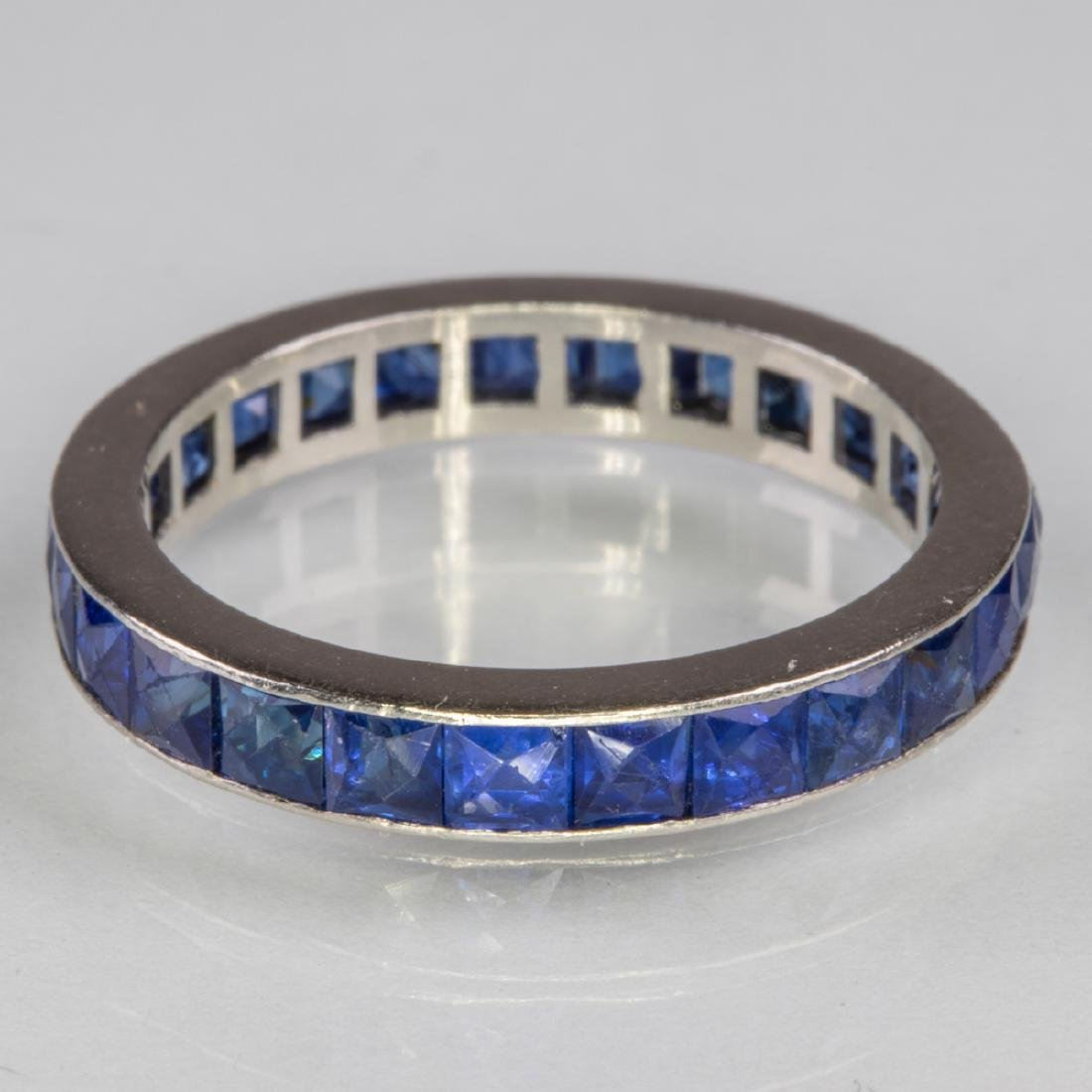 A 14kt. White Gold and Sapphire Eternity Band,
