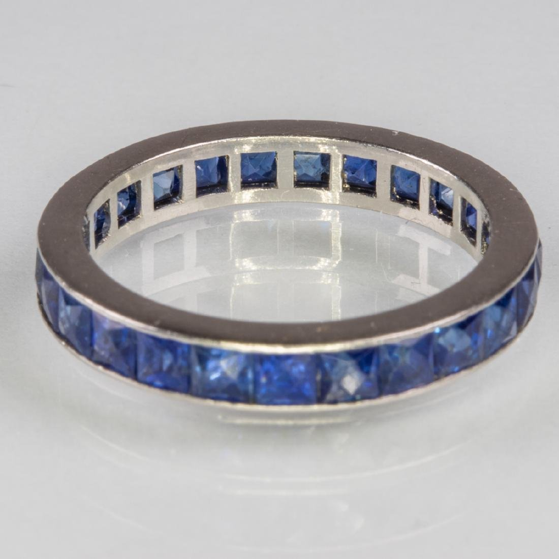A 14kt. White Gold and Sapphire Eternity Band, - 4