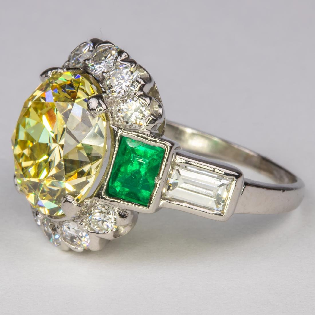A Platinum, Diamond and Emerald Ring, - 10