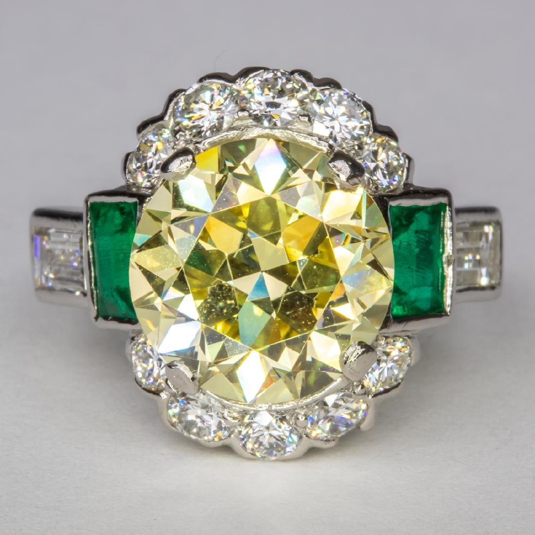 A Platinum, Diamond and Emerald Ring,