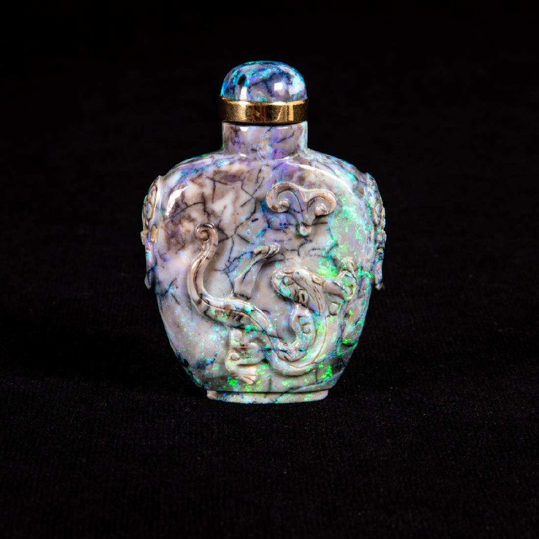 A Chinese Carved Black Opal Snuff Bottle,