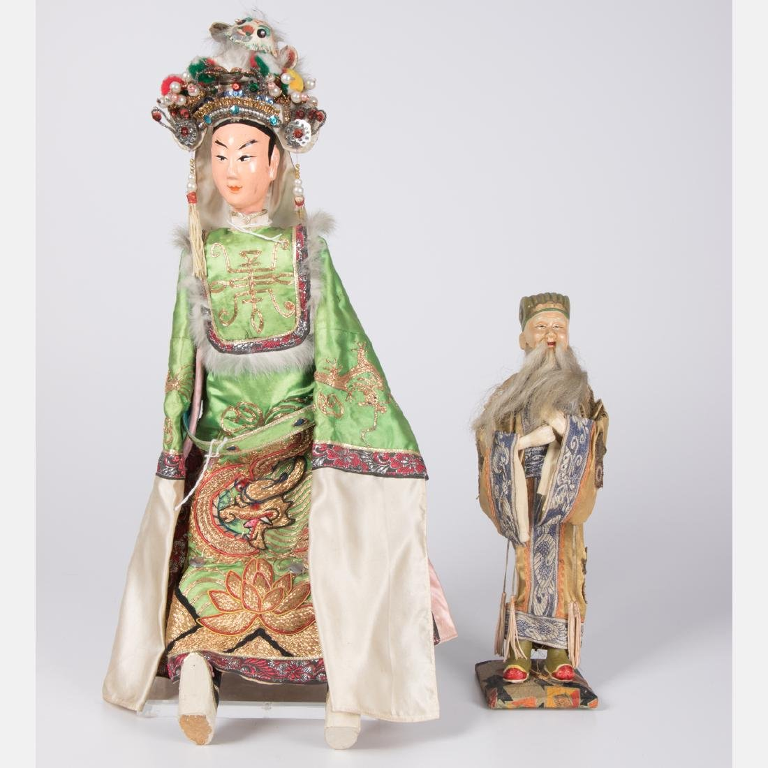 Two Chinese Painted Wood and Plaster Dolls, 20th