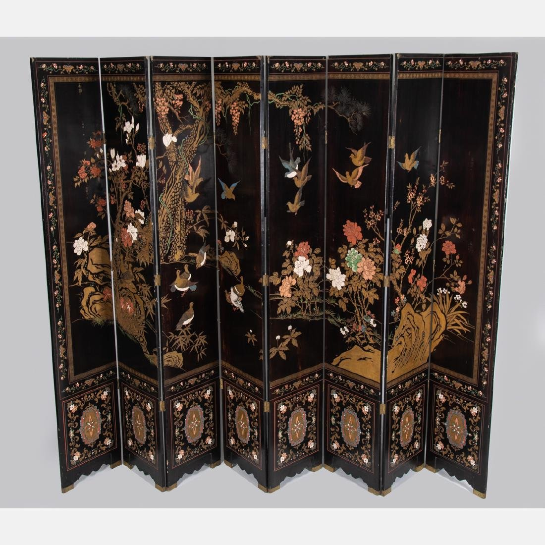 A Chinese Carved Lacquered and Gilt Painted Eight Panel