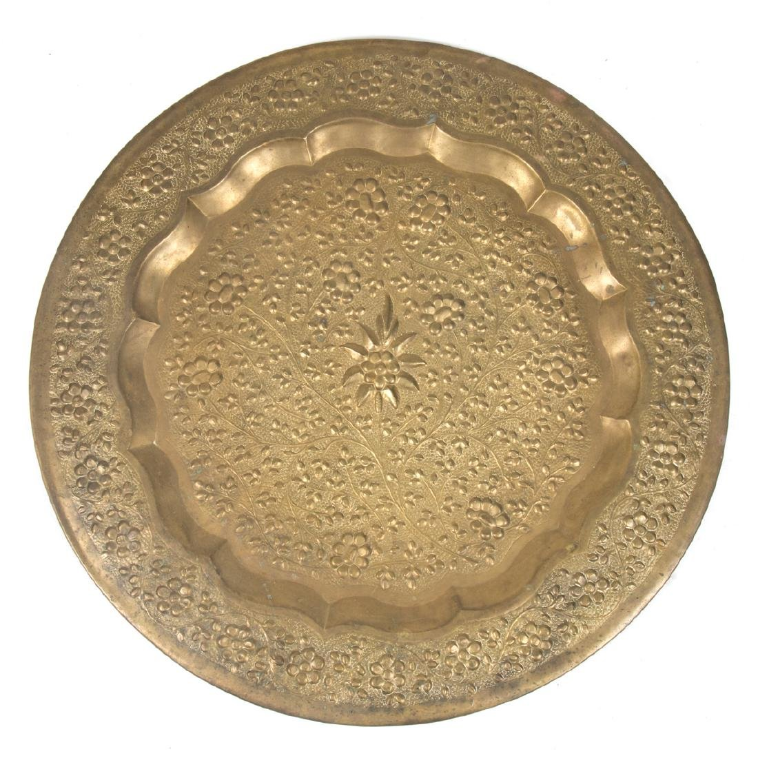 A Persian Repousse Brass Circular Tray, 20th Century.