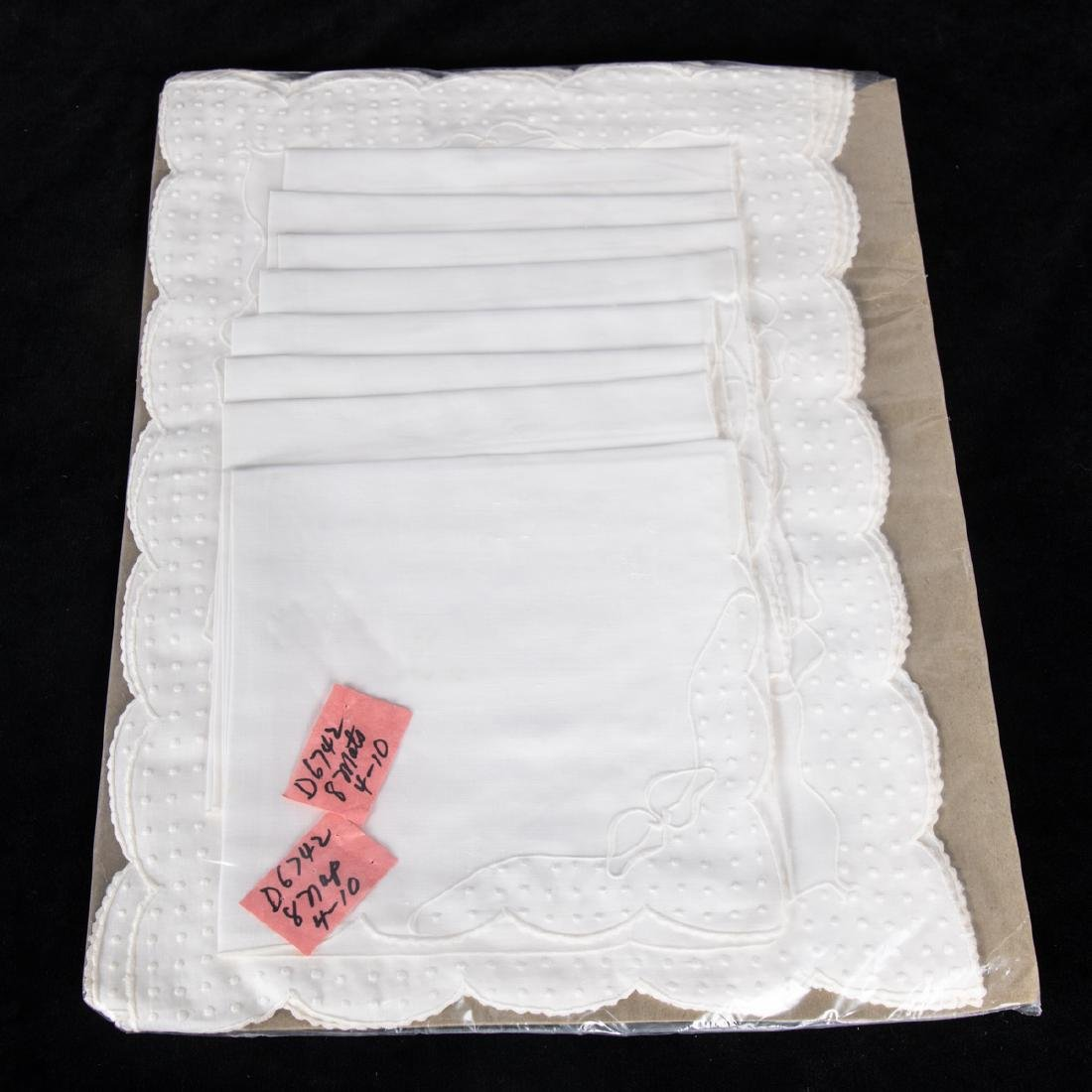 A Set of Sixteen Dotted Swiss Linen Napkins and
