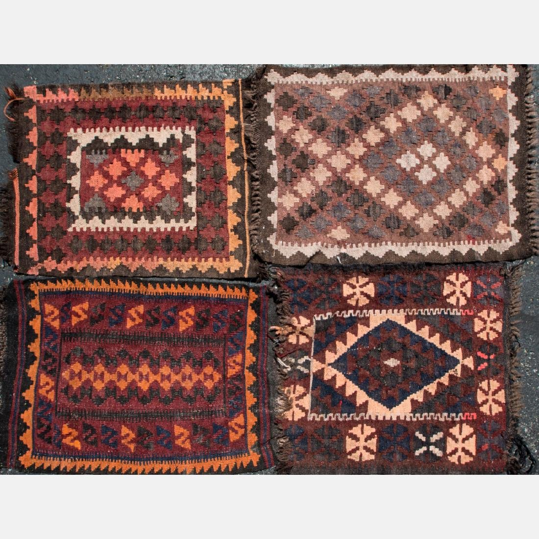 A Group of Four Afghan Wool Rugs, 20th Century.