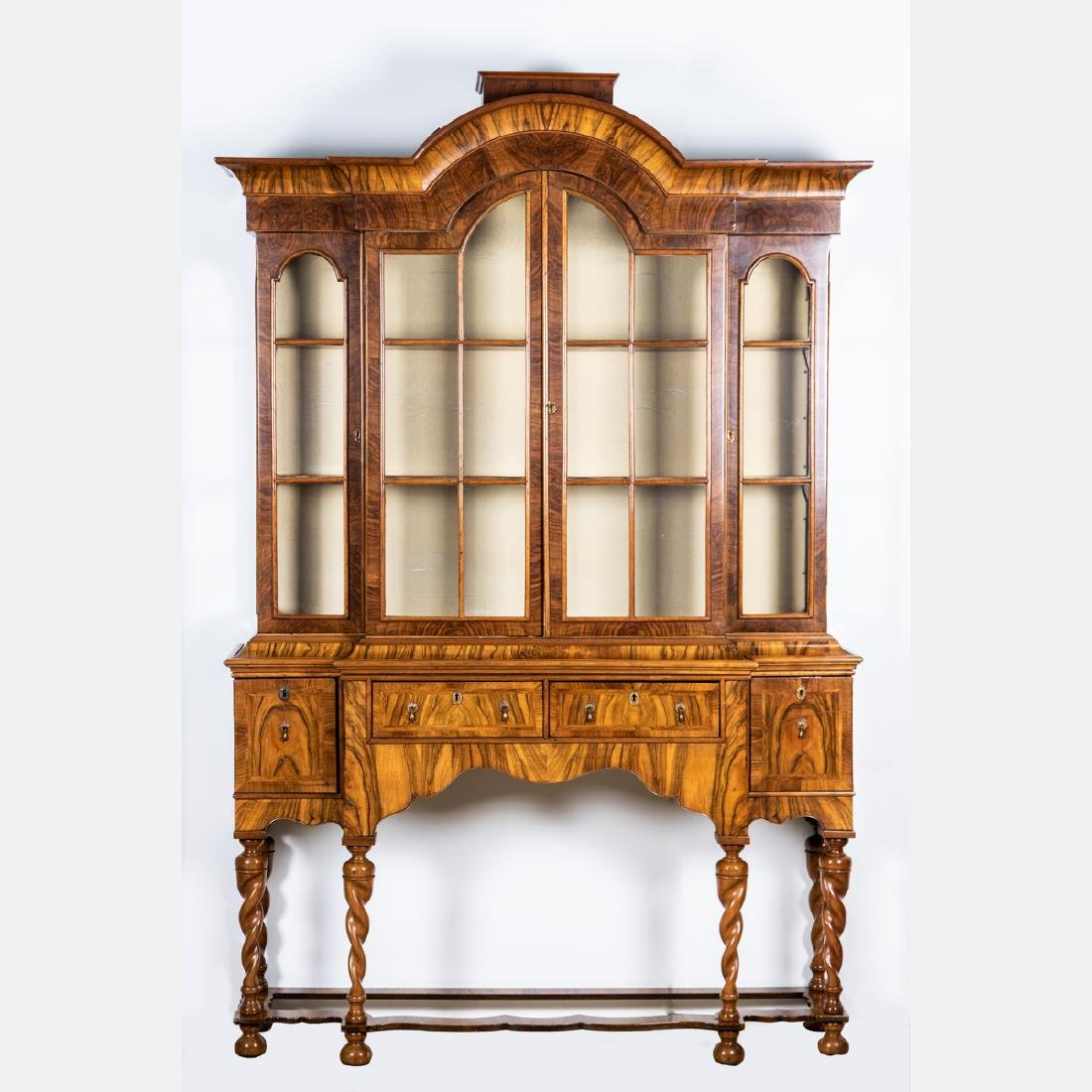 A William and Mary Style Walnut Breakfront, 20th