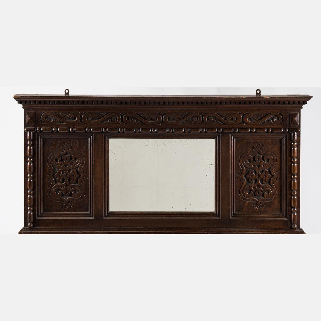 An English Carved Oak Mirror, 20th Century.