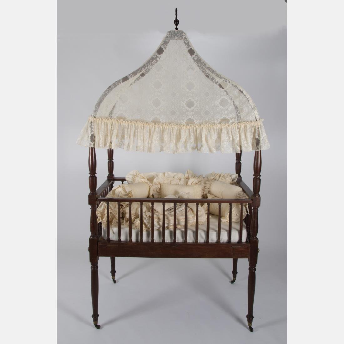 A Victorian Mahogany Doll's Cradle with Canopy, 19th