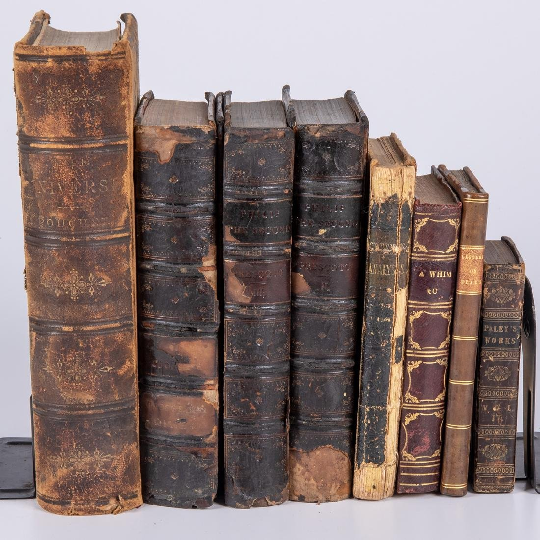 A Miscellaneous Collection of Eight Leather Bound Books