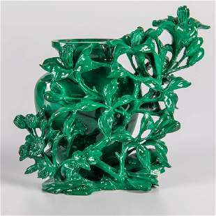 A Chinese Carved Malachite Vase with Floral Vine Form