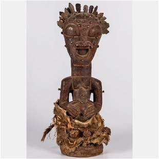 A Songye Tribe Carved Wood and Copper Nail Fetish