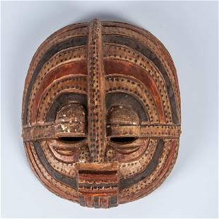 A Luba Tribe Carved and Painted Wood Moon Mask