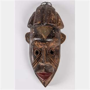 A Bassa Tribe Carved Wood and Copper Mask Liberia