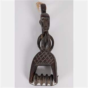 A West African Style Carved Wood Figural Heddle Pulley