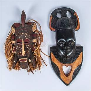 Two African Carved Wood Masks 20th Century