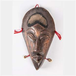 An African Carved Wood and Cowrie Shell Mask 20th