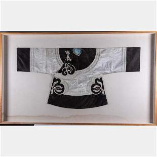 An Asian Silk embroidered Jacket in a Shadowbox Frame
