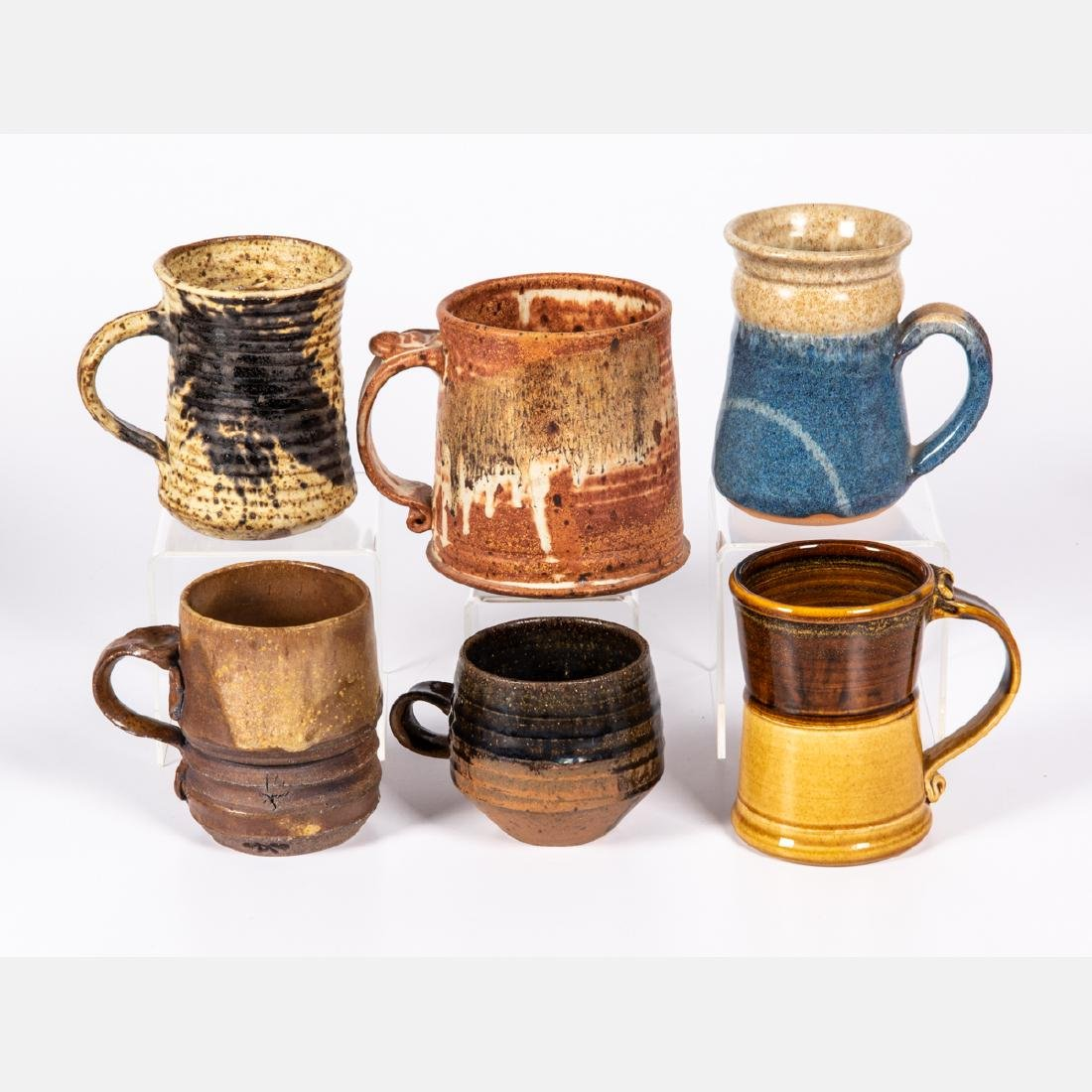 A Group of Six Glazed Stoneware and Earthenware Mugs by