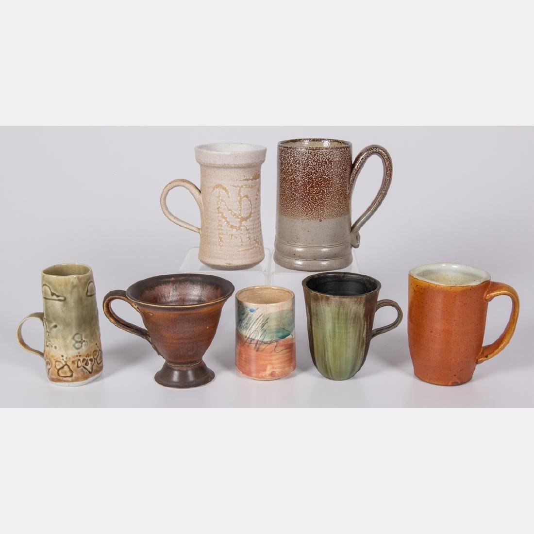 A Group of Seven Glazed Ceramic Mugs by Various Makers,
