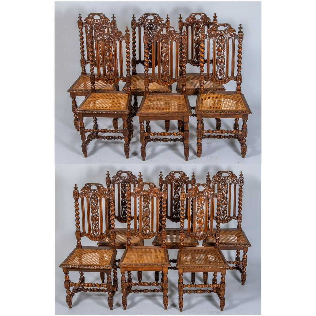 A Set of Twelve American Carved Oak Side Chairs with